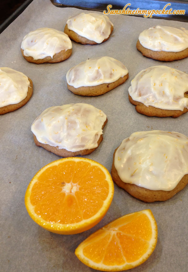 frosted-cookies-on-sheet-with-oranges